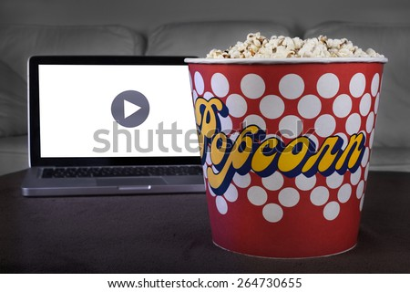 Movie online with popcorn at home  - stock photo