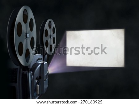 Movie projector and blank screen - stock photo