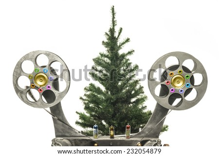 Movie projector and new years tree on a white background - stock photo