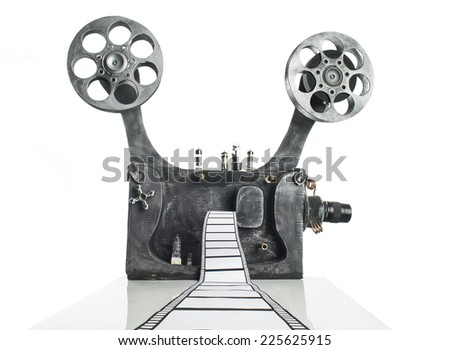 Movie projector with the film on the white background - stock photo