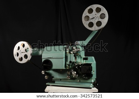 Movie projector with the film on the white background