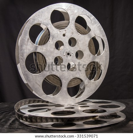 Movie reel on a black background - stock photo