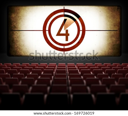 Movie Screen countdown in old retro cinema, view from audience - stock photo