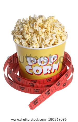 Movie theater still life with popcorn bucket and tickets on white - stock photo