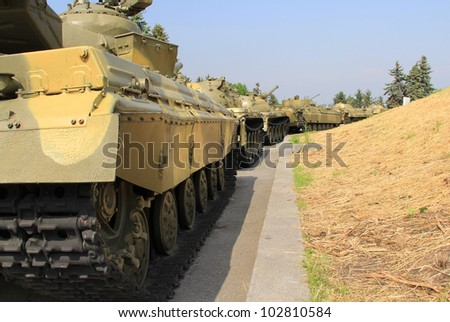 Moving armored  column against  grass background