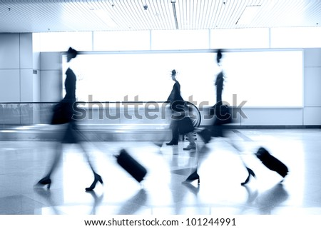 moving blur people in airport - stock photo