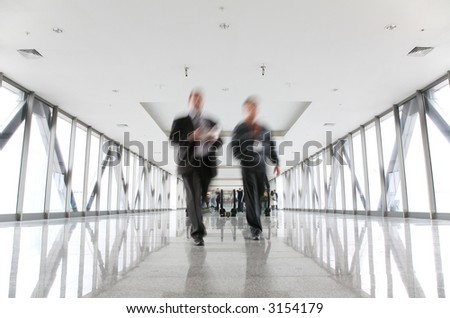 moving businessmen and escalator - stock photo