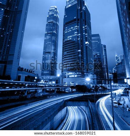 moving car with blur light through hongkong city at night  - stock photo