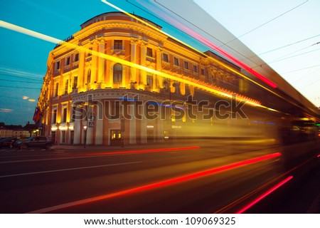 Moving cars in city center (Twilight in St. Petersburg, Russia)