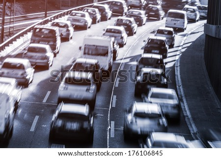 moving cars on a highway - stock photo