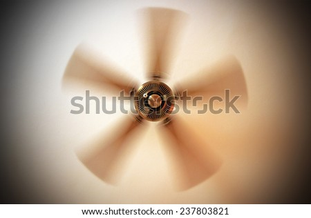 Moving ceiling fan in a hotel room - stock photo