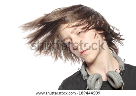 moving cool teenager boy with headphones, isolated on white. - stock photo
