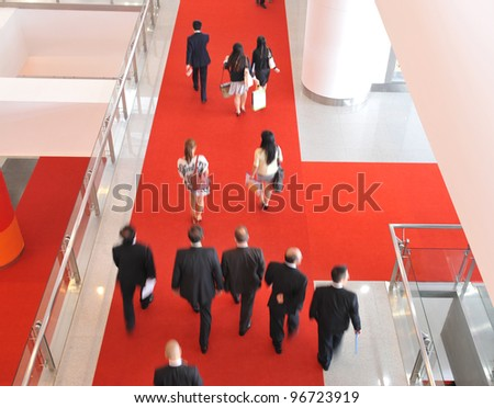 Moving crowd  in a international exhibition. motion blur - stock photo