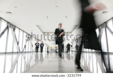 moving crowd in corridor 2 - stock photo