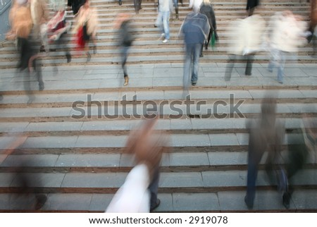 moving crowd on stair