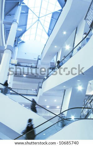 Moving crown in modern interior - stock photo