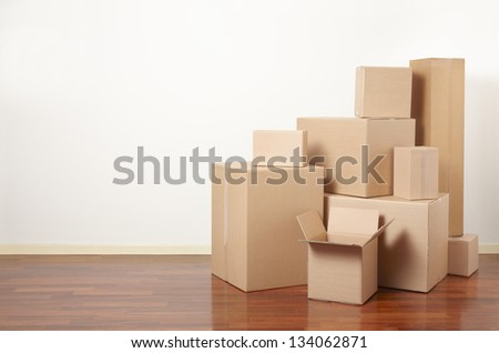 Moving day, cardboard boxes in apartment - stock photo