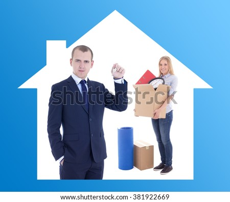 moving day concept - businessman real estate agent giving key to happy woman with cardboard boxes - stock photo