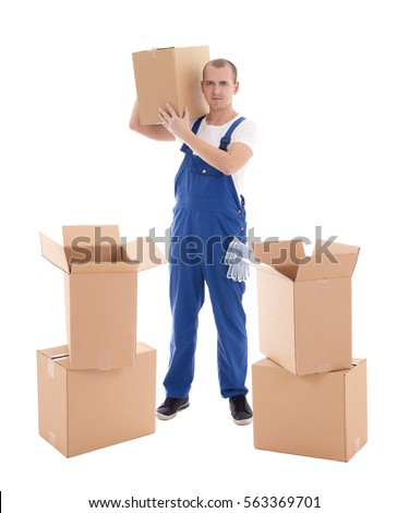 moving day concept - young man in blue workwear with cardboard boxes isolated on white background