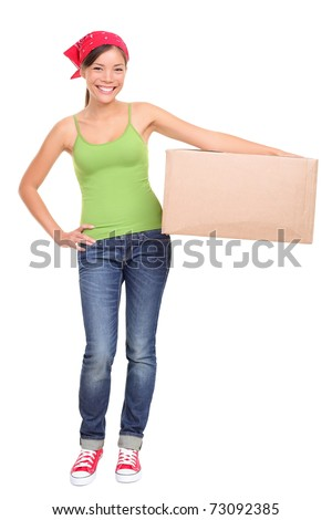 Moving day. Young woman holding cardboard moving box. Asian Caucasian female model isolated on white background standing in full length. - stock photo