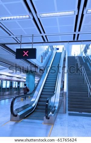 Moving escalator - stock photo