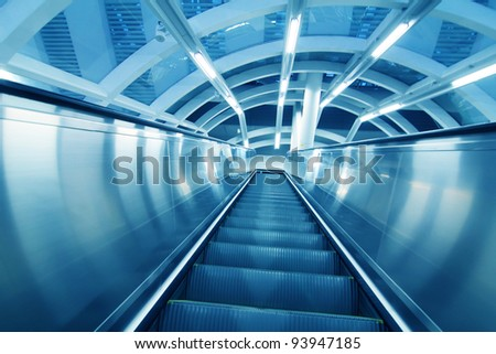 moving escalator in modern airport hall