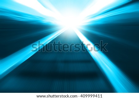 Moving escalator in motion blur and light on background. - stock photo