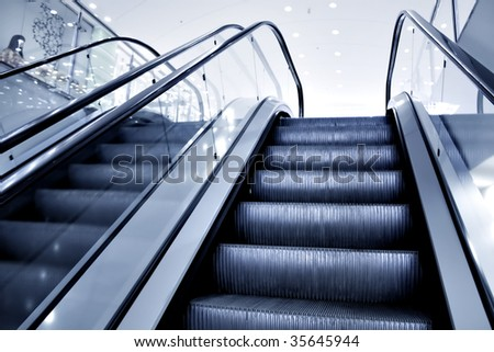 Moving escalator in office center