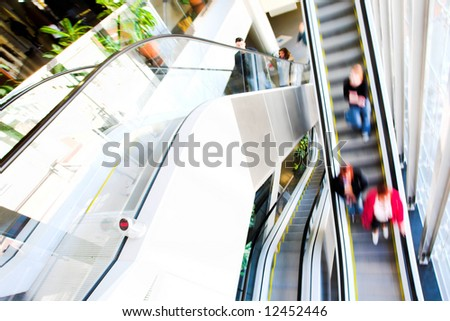 moving escalator in the office hall - stock photo