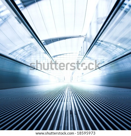 moving  escalator in the office hall perspective view - stock photo