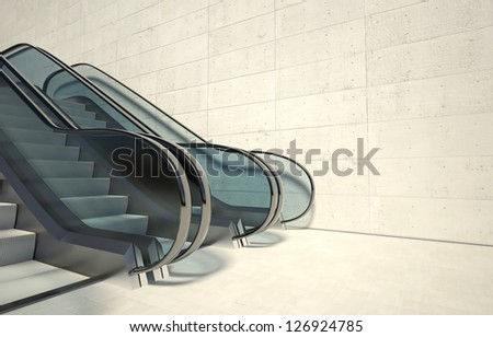 Moving escalator stairs and empty wall in modern office building - stock photo