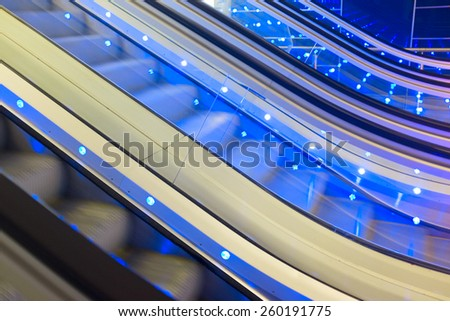 Moving Escalator with blue lights. Detail. Abstract background. - stock photo