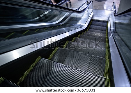 Moving escalator without people in business centre