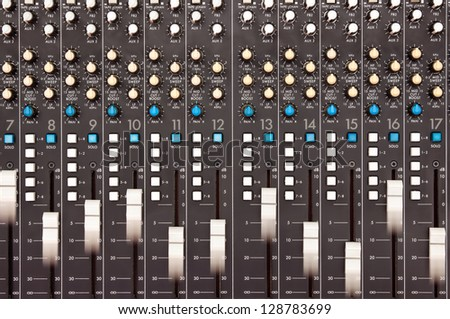 Moving faders on a mixing desk - motion blur