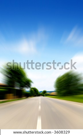 moving fast on a road in a beautiful landscape on a sunny day