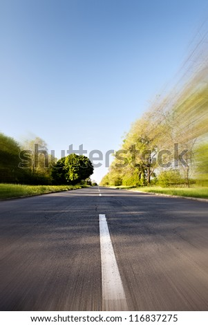 Moving fast on country road - stock photo