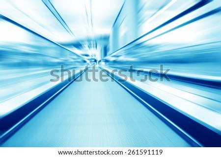 moving flat escalator indoor - stock photo