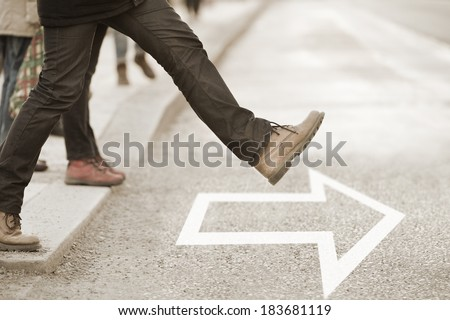 Moving forward, daring to take the step - stock photo