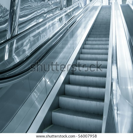 moving gray escalator in airport - stock photo