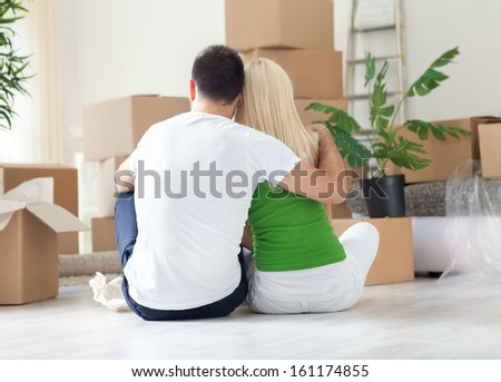 Moving House, couple resting - stock photo