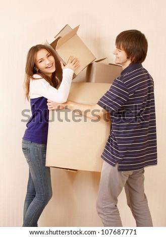 Moving House, holding boxes - stock photo