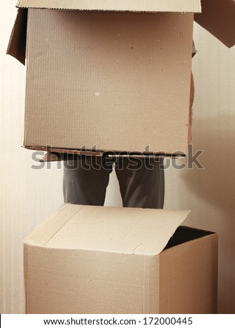 Moving House, holding boxes - stock photo