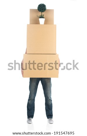 Moving house. Man carrying stack of boxes - stock photo
