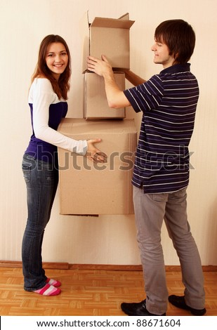 Moving House, woman sitting on the floor with  cup - stock photo