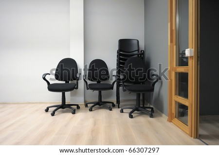 Moving in - chairs arranged in stack in new office. - stock photo