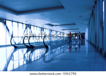moving people near the escalator in the office hall - stock photo