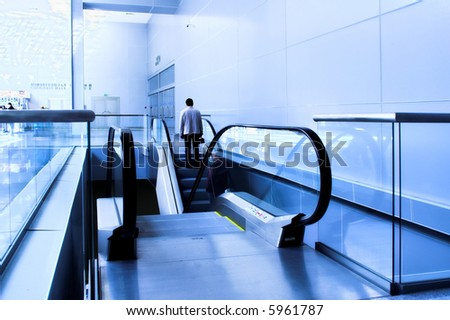 moving people on the escalator - stock photo