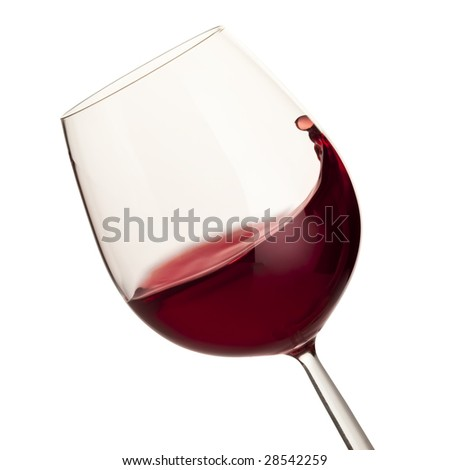 Moving red wine glass isolated over white background