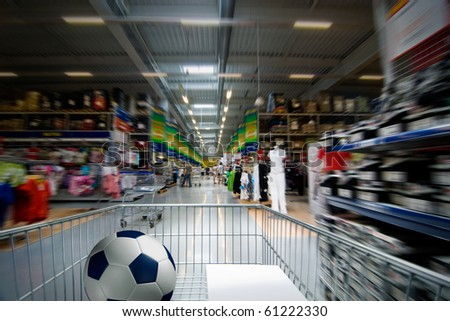 Moving shopping cart in the supermarket interior. - stock photo