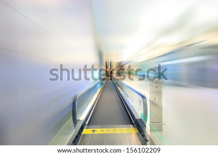 Moving shot for modern escalator at a international airport,hongqiao,shanghai - stock photo
